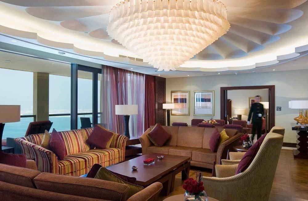 sofa property chair Resort Lobby living room Suite recreation room condominium leather