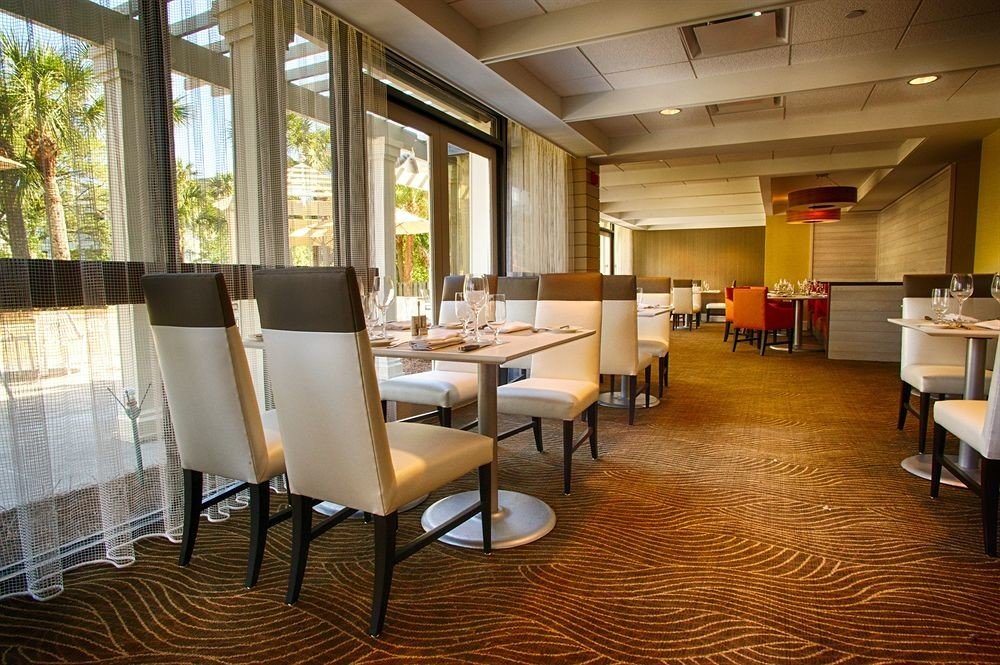 chair property Lobby condominium restaurant Suite living room Resort home function hall conference hall