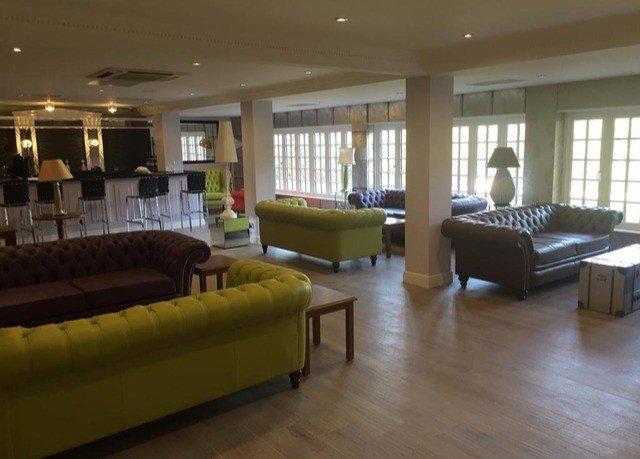 sofa property condominium living room Lobby waiting room recreation room conference hall Resort Suite hard