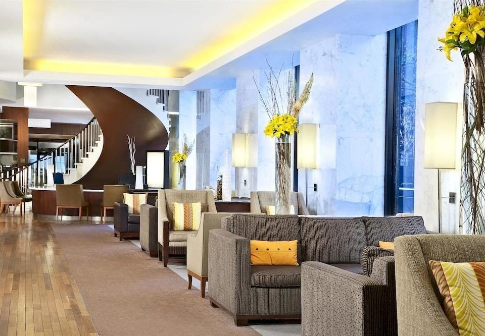 property Lobby yellow living room home condominium Suite Resort