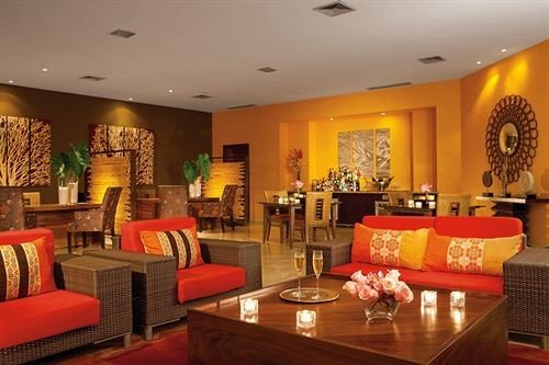 sofa property Lobby living room Suite Resort function hall recreation room restaurant orange leather flat