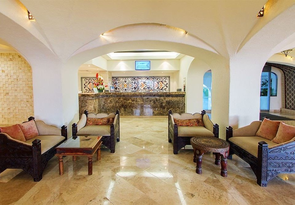 sofa property living room Villa home mansion Suite Lobby cottage Resort recreation room hacienda