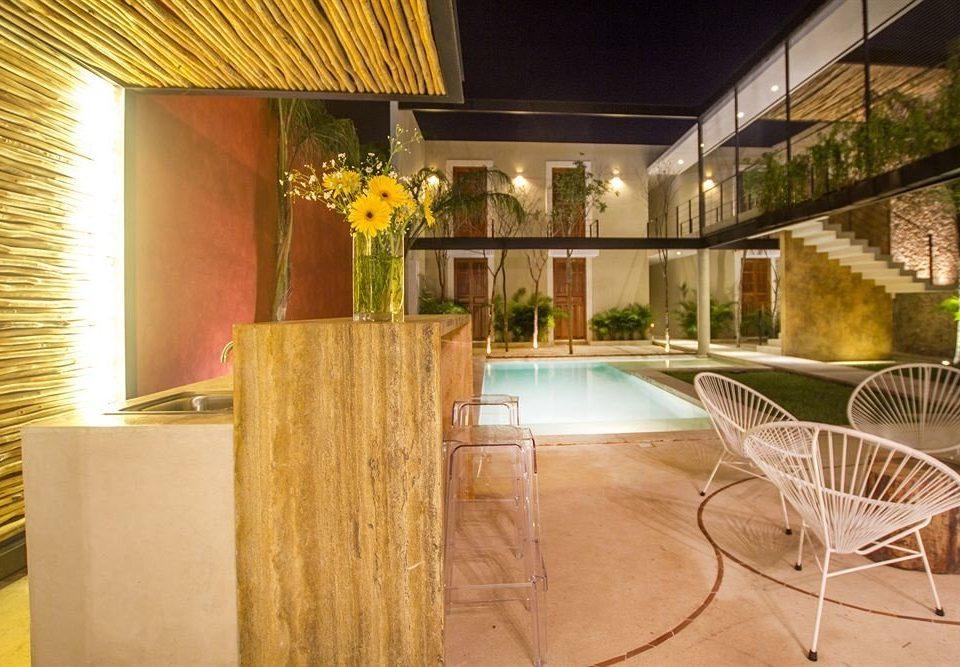 chair property Lobby home condominium Villa Suite restaurant Resort mansion cottage porch