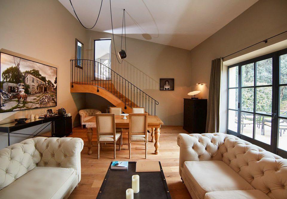 sofa property living room condominium home Villa Lobby Suite Resort mansion cottage loft flat