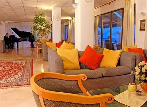 chair property Suite living room leisure Resort Lobby Villa cottage condominium