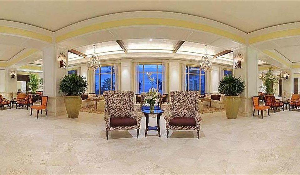 Lobby property chair building palace mansion home function hall Villa ballroom Resort convention center hacienda rug