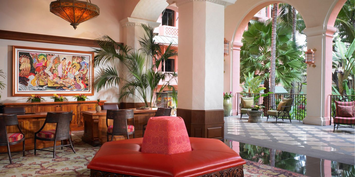 red chair property living room home Lobby mansion hacienda Villa porch pink Resort