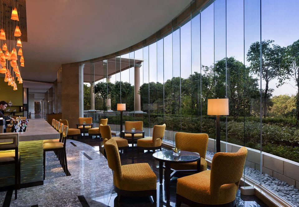 chair property Lobby condominium living room home restaurant Villa Resort