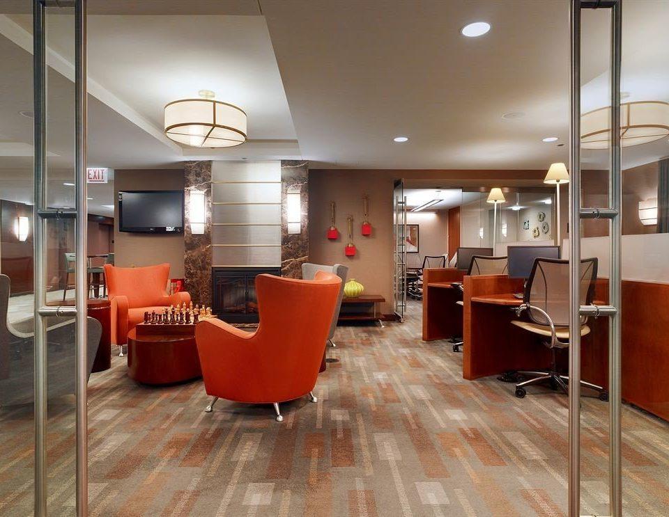 building chair property Lobby orange condominium flooring office loft living room Suite
