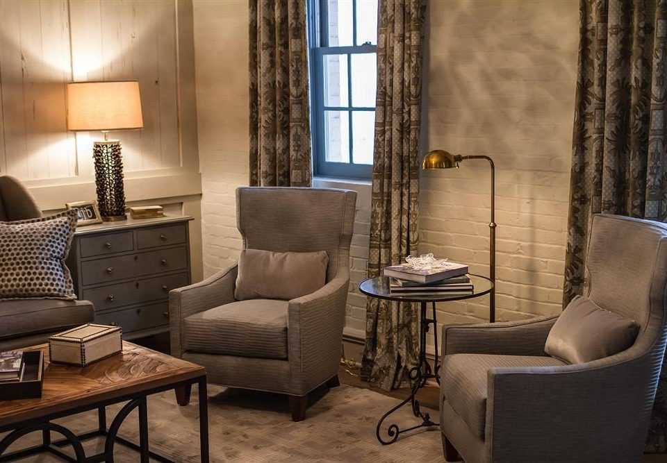 living room chair property home Suite condominium cottage Lobby