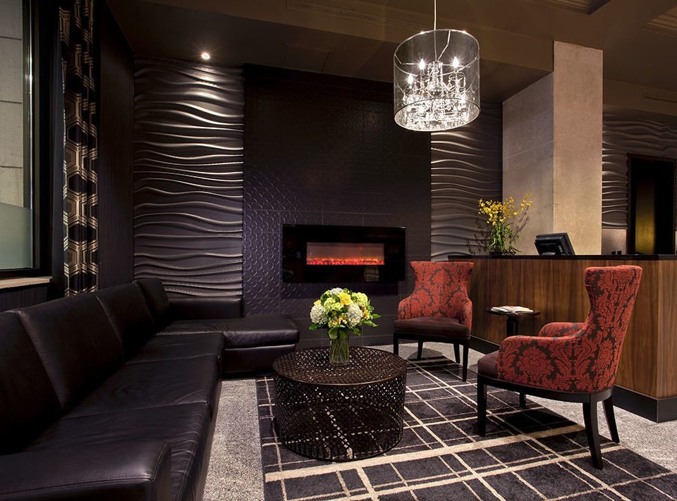 living room chair property Lobby home lighting Suite condominium leather