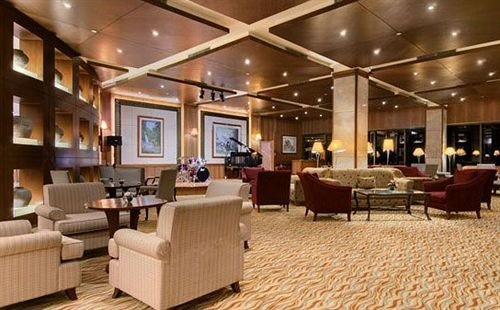 Lobby property chair living room recreation room lighting condominium Suite convention center flooring
