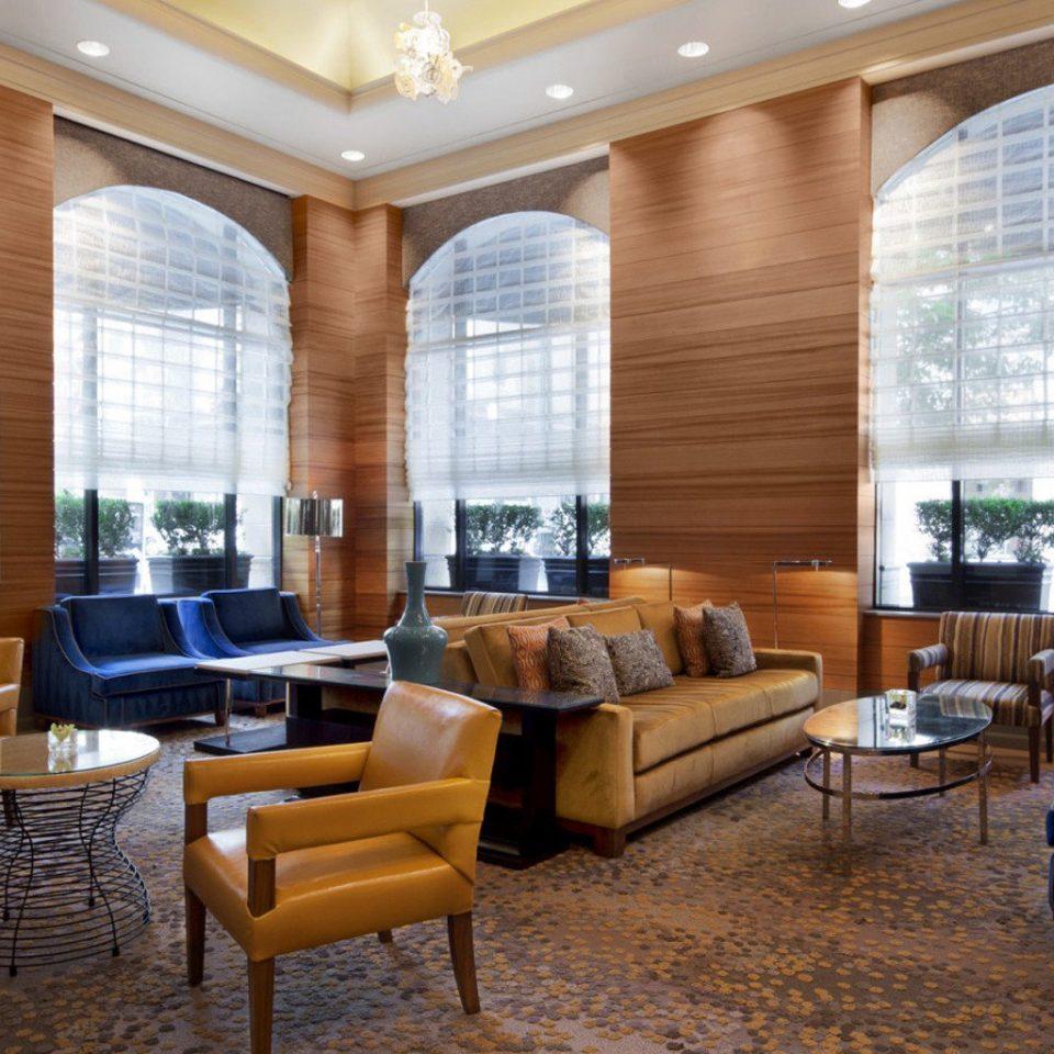 chair property living room Lobby condominium home Suite window treatment