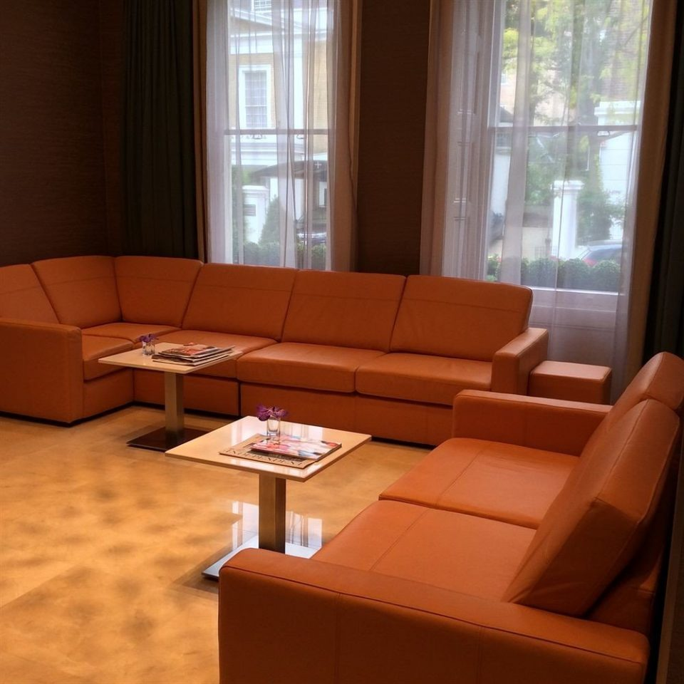 property living room waiting room Lobby sofa couch chair Suite seat conference hall