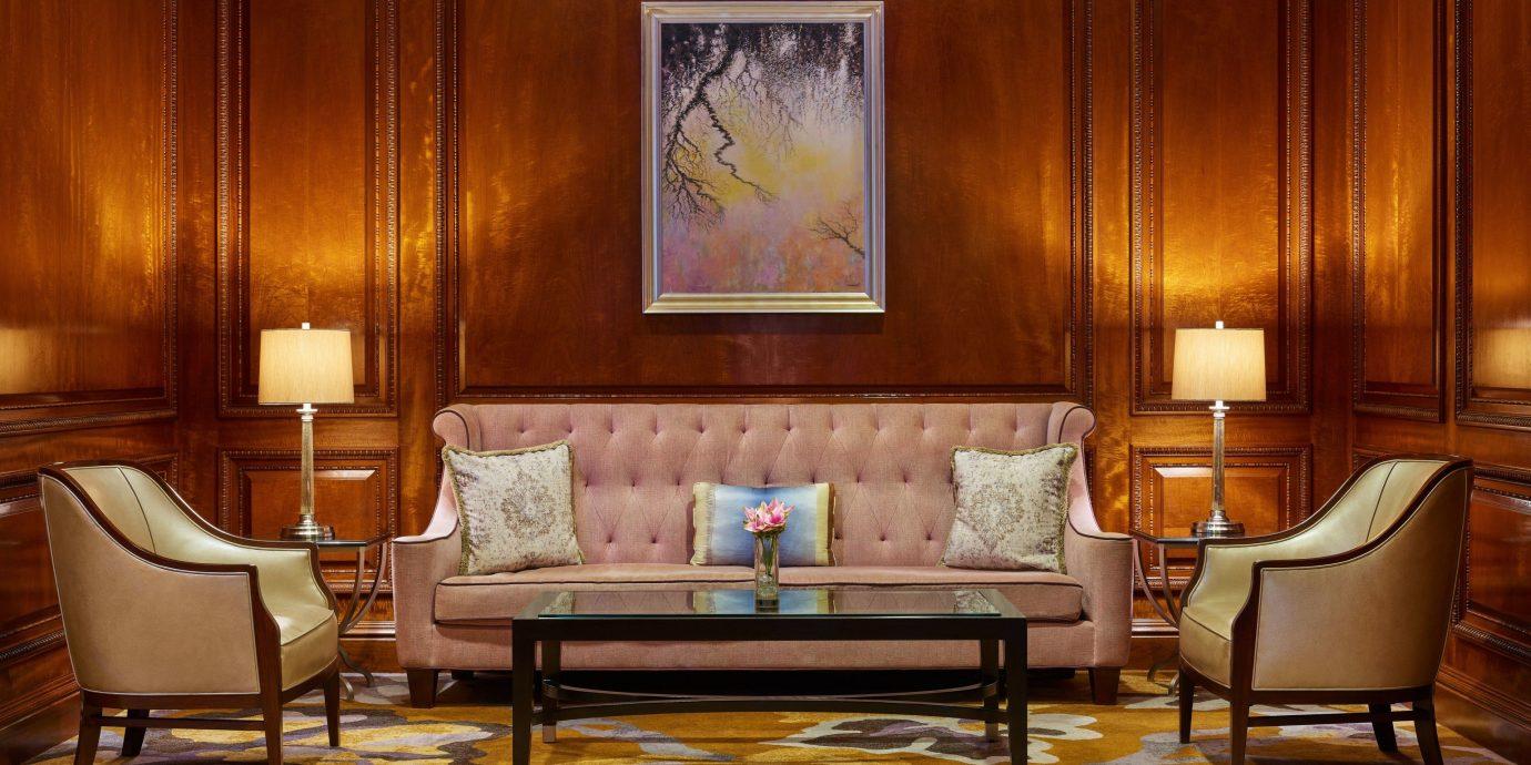 living room Lobby home couch Suite chair wooden flooring hardwood interior designer loveseat