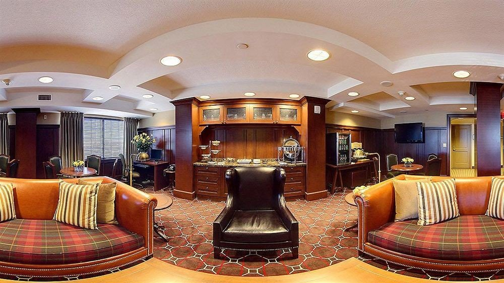 sofa chair property Lobby recreation room living room Suite home yacht mansion vehicle leather