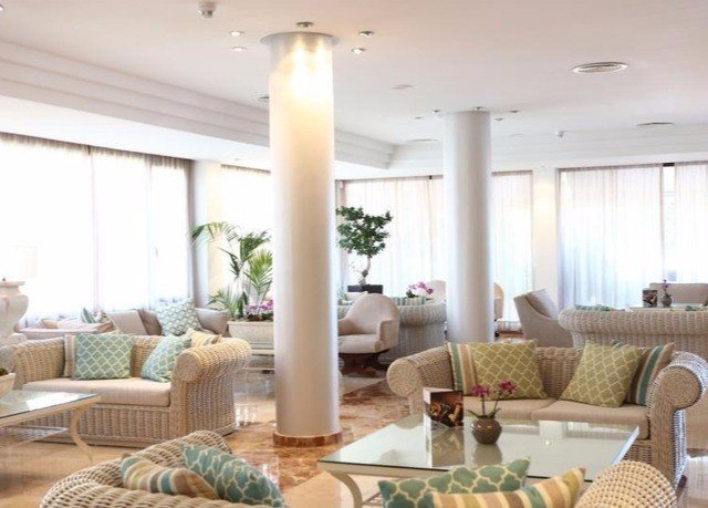 sofa living room property condominium home lighting Suite Lobby cluttered