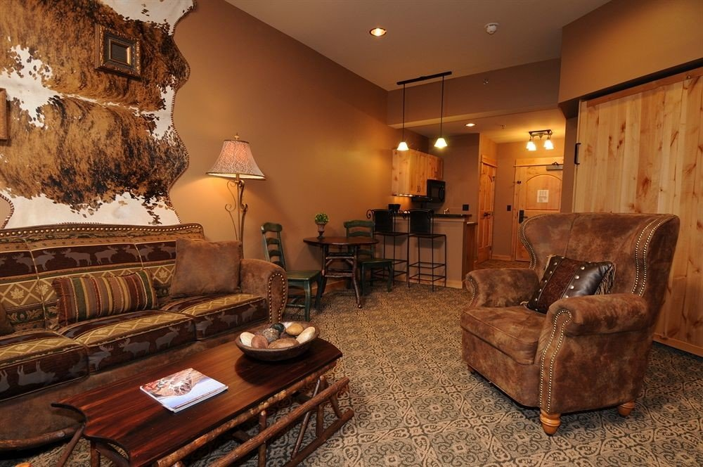 sofa property living room home Lobby Suite cottage leather cluttered