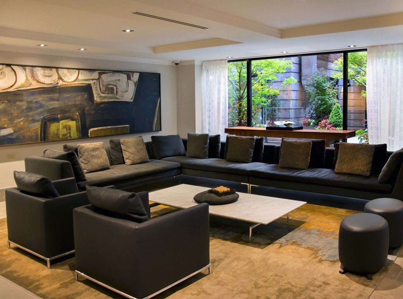sofa living room property Lobby condominium home waiting room recreation room conference hall Suite