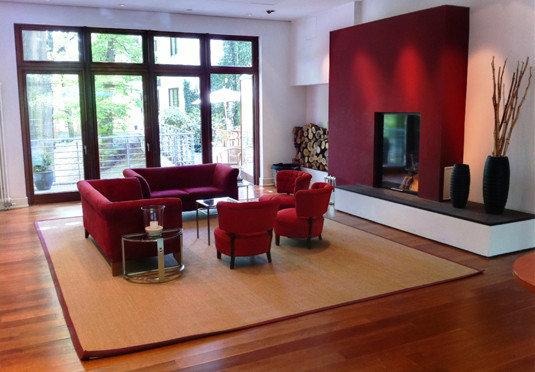 living room property hardwood home wooden condominium Lobby wood flooring flooring Suite waiting room hard dining table