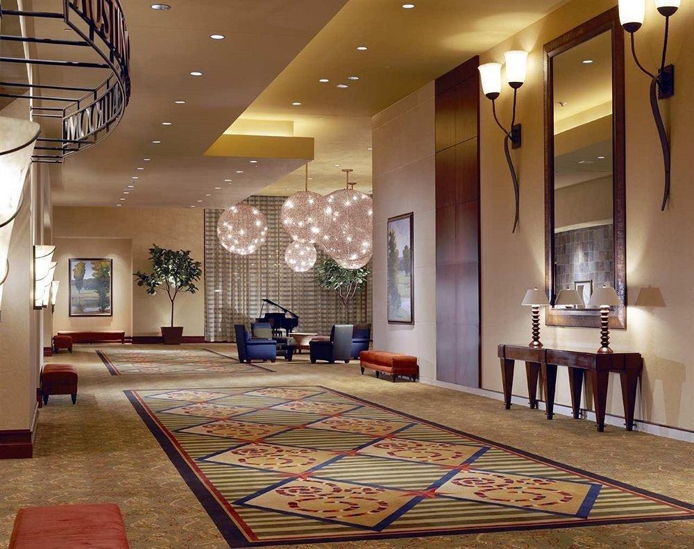 Lobby property living room hardwood flooring home mansion condominium wood flooring recreation room Suite
