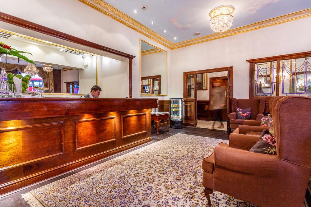 property Lobby home living room mansion hardwood recreation room Suite condominium rug