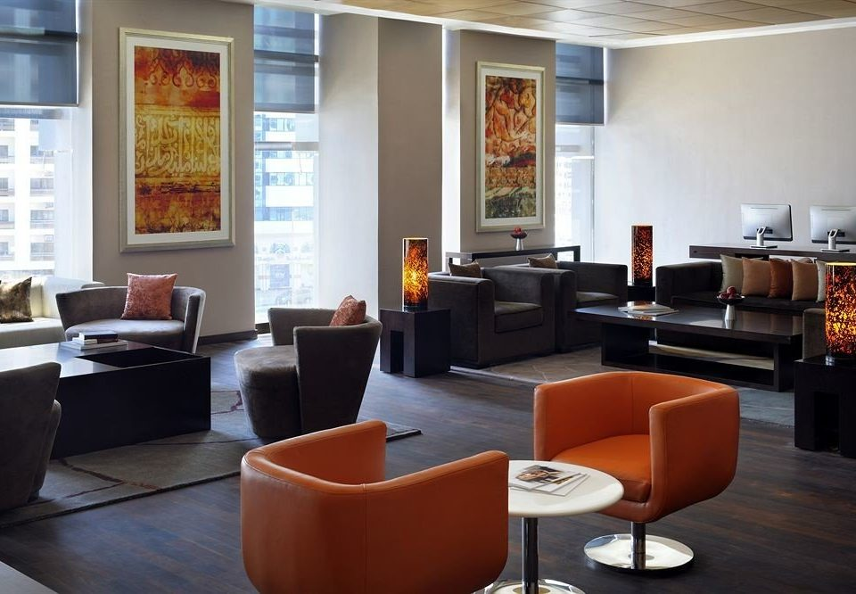 orange property living room Lobby home condominium Suite waiting room