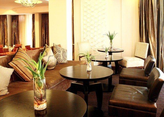 sofa property living room Suite home Lobby condominium