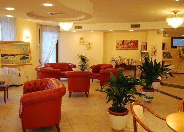property Lobby condominium living room Suite waiting room plant orange