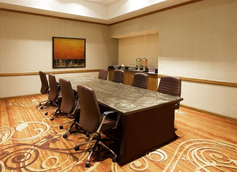 property Suite conference hall recreation room Lobby wood flooring living room flooring