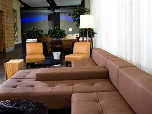sofa living room property condominium Lobby Suite home Villa couch leather