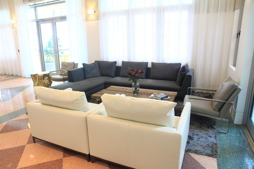 sofa living room property condominium Lobby home couch Suite waiting room Villa seat cottage