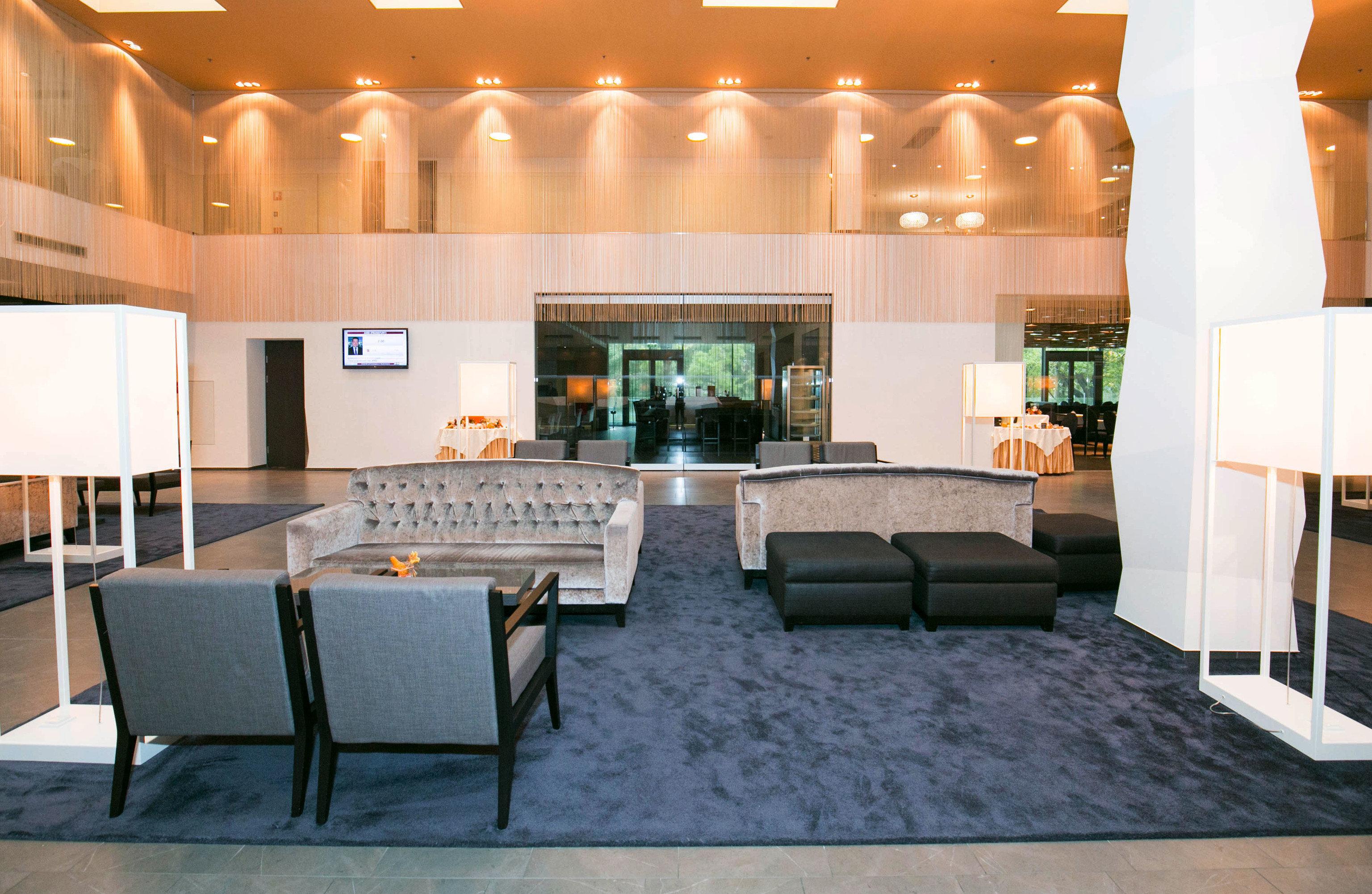 Lobby property living room recreation room function hall home Suite flooring Villa condominium mansion