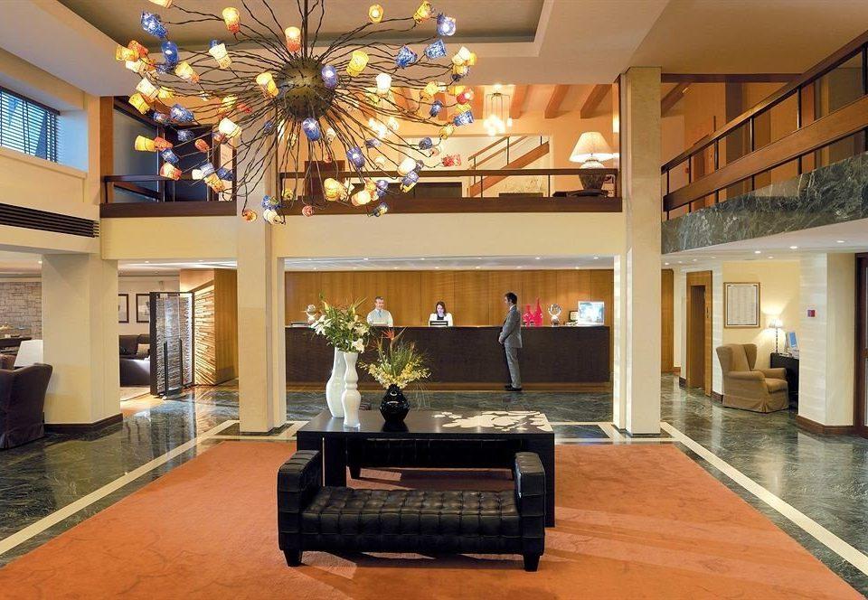 property Lobby living room home hardwood mansion recreation room condominium Villa wood flooring