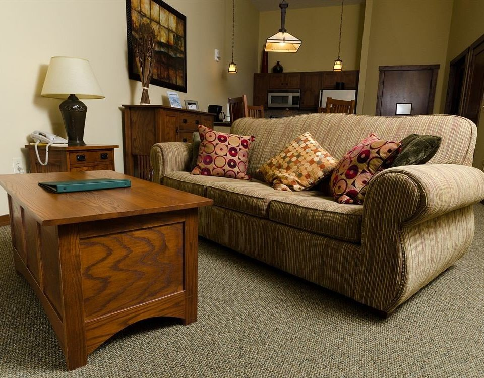 Lodge sofa living room hardwood home flooring studio couch couch bed sheet wood flooring