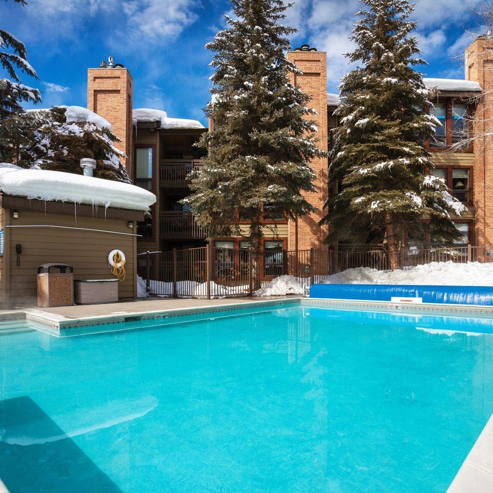 Lodge Outdoors Pool Scenic views Ski tree swimming pool property backyard house home Resort Villa swimming