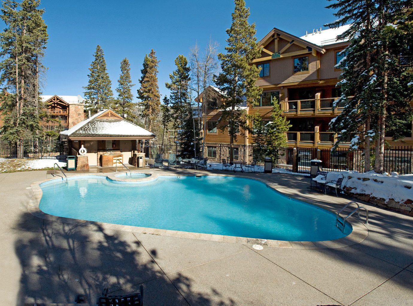 Lodge Patio Pool Rustic tree sky swimming pool leisure property Resort house home backyard Villa blue