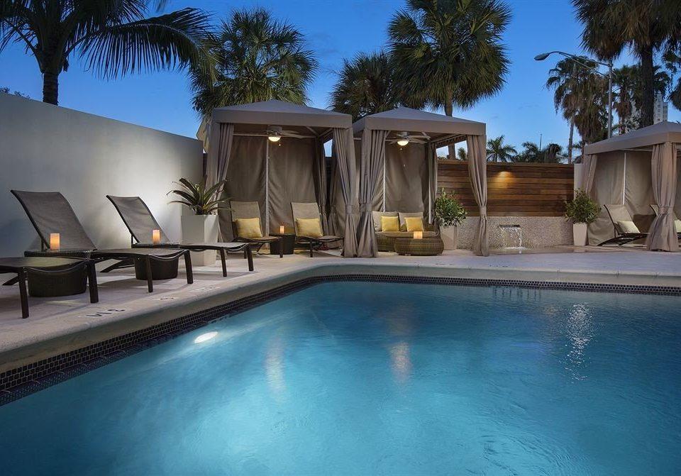 Lounge Luxury Modern Pool tree swimming pool property Villa Resort backyard mansion home