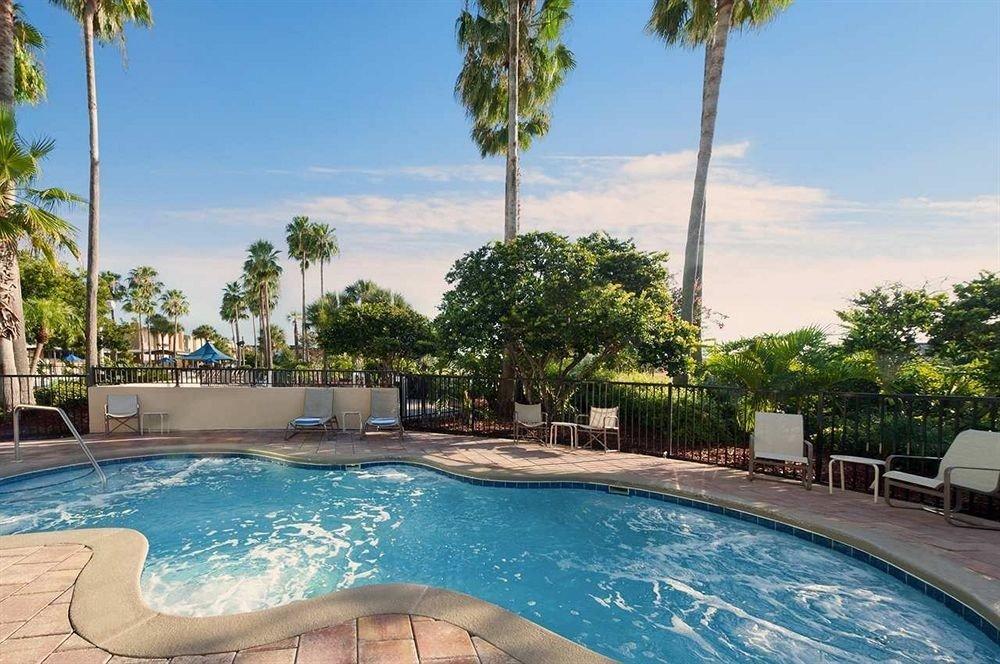 Lounge Luxury Pool tree sky water Resort swimming swimming pool property leisure condominium Villa resort town backyard mansion