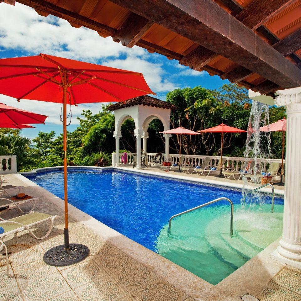 Lounge Luxury Pool umbrella leisure swimming pool property chair Resort building Villa hacienda backyard Water park blue