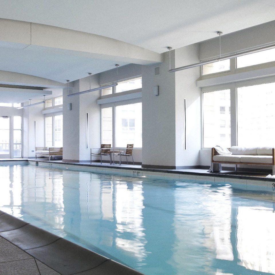 Lounge Luxury Pool swimming pool property building condominium leisure centre daylighting home Villa living room