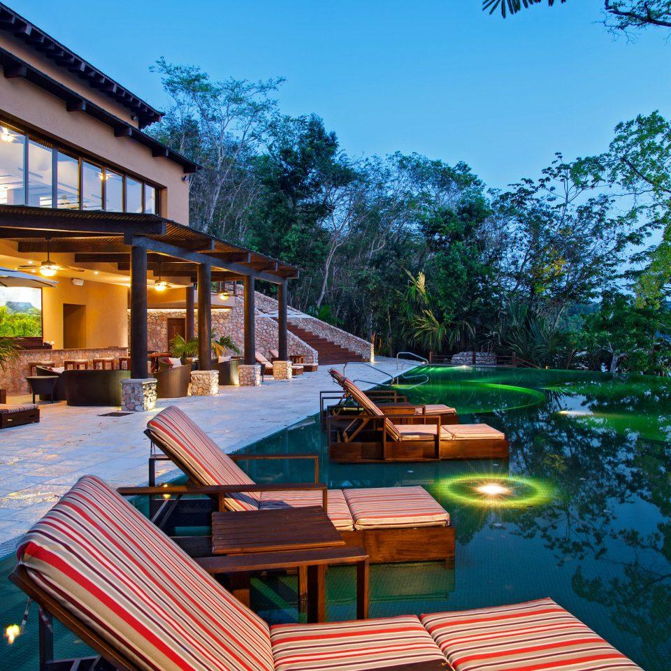 Lounge Luxury Scenic views tree leisure property Resort swimming pool house home Villa backyard cottage