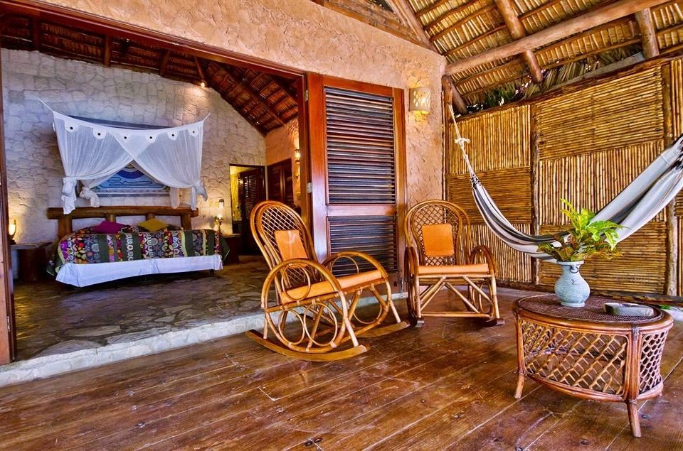 Lounge Luxury Romantic Tropical chair property building home house living room hardwood mansion cottage wooden Villa farmhouse log cabin wood flooring Suite