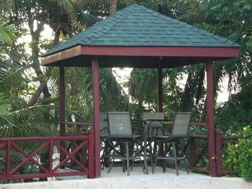 Lounge Luxury Tropical tree ground chair building gazebo wooden outdoor structure green pavilion cottage canopy pergola porch house shade