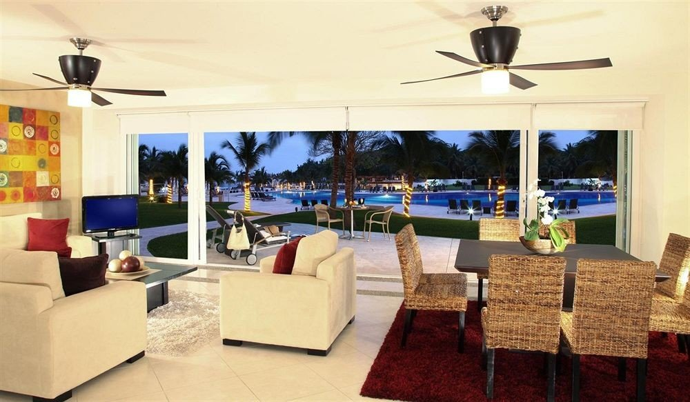 Lounge Patio Pool Suite property Resort Villa restaurant living room condominium
