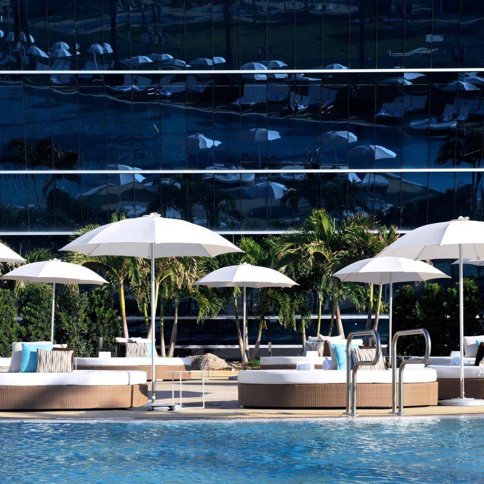 Lounge Play Pool Resort Trip Ideas umbrella chair swimming pool marina dock