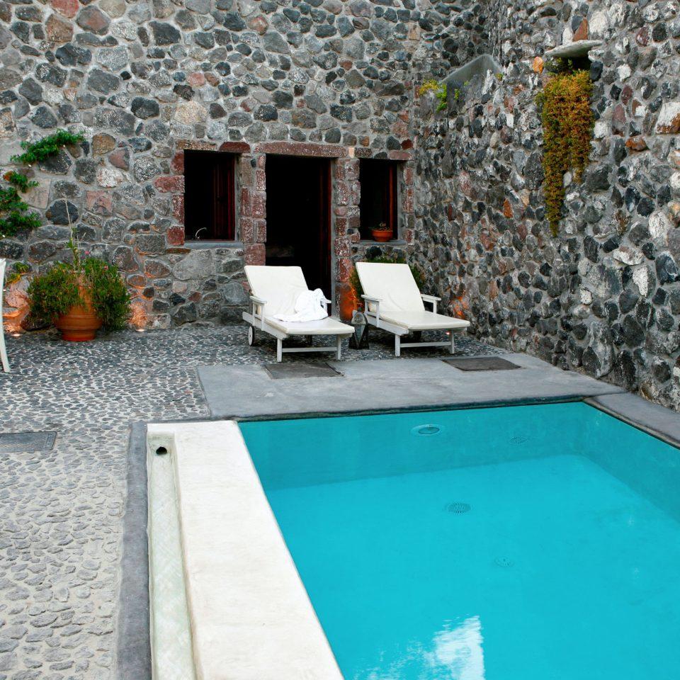 Lounge Pool swimming pool house property building backyard home Villa cottage stone