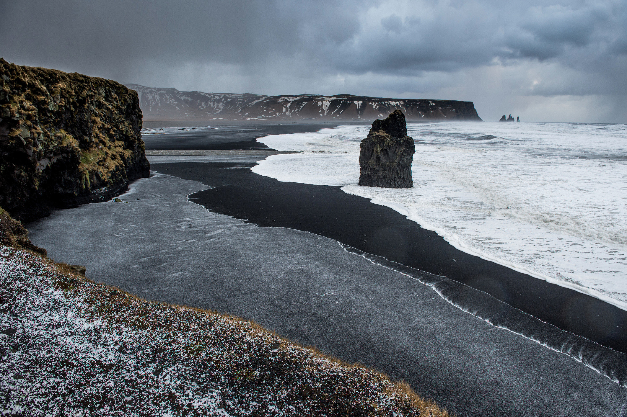 Iceland Outdoors + Adventure Road Trips sky water outdoor Nature body of water Coast Sea coastal and oceanic landforms shore Ocean wave headland cliff terrain rock wind wave cloud Beach promontory tide landscape formation
