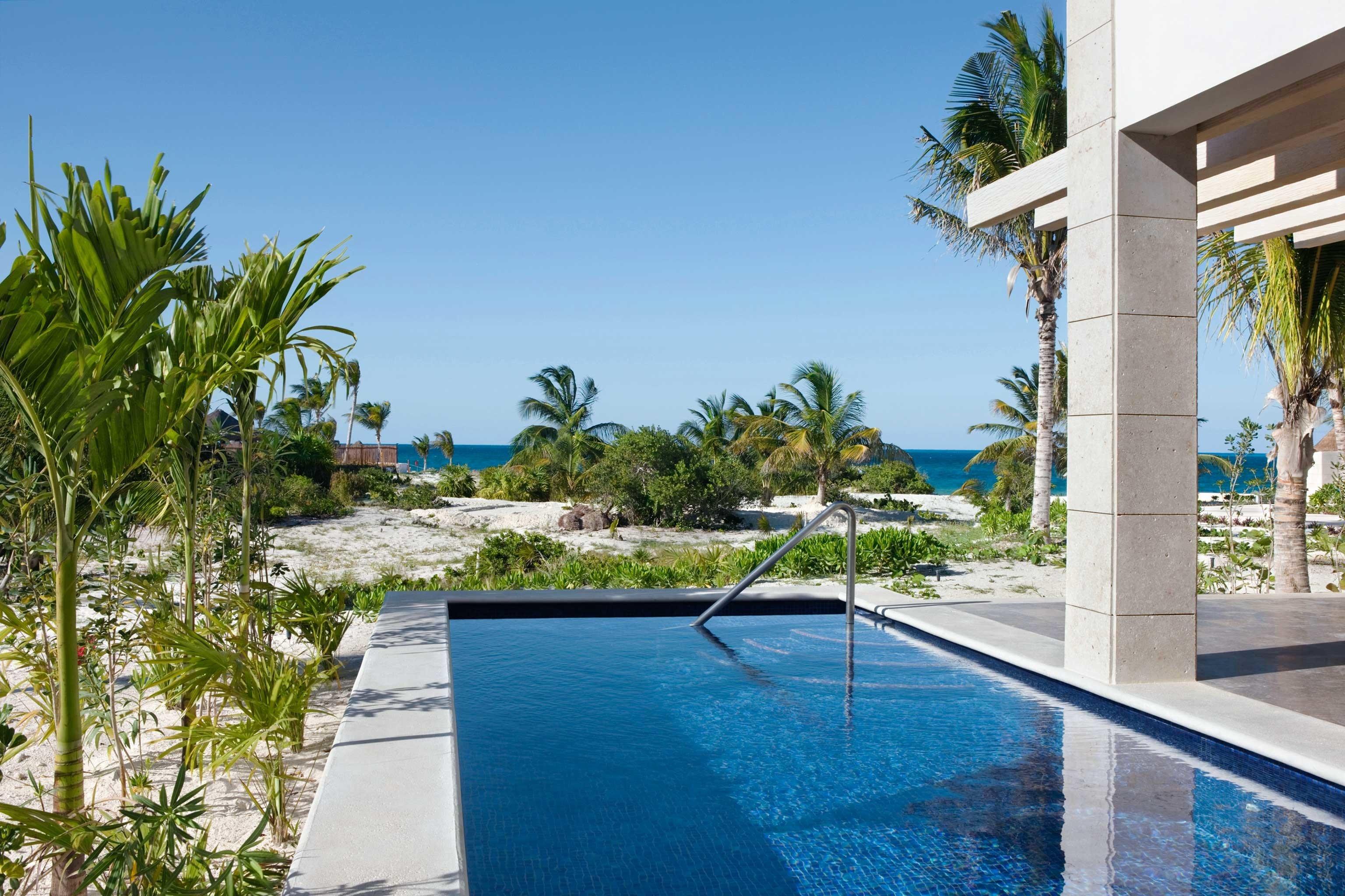 Luxury Modern Pool Tropical tree sky swimming pool property leisure Resort Villa condominium home backyard mansion