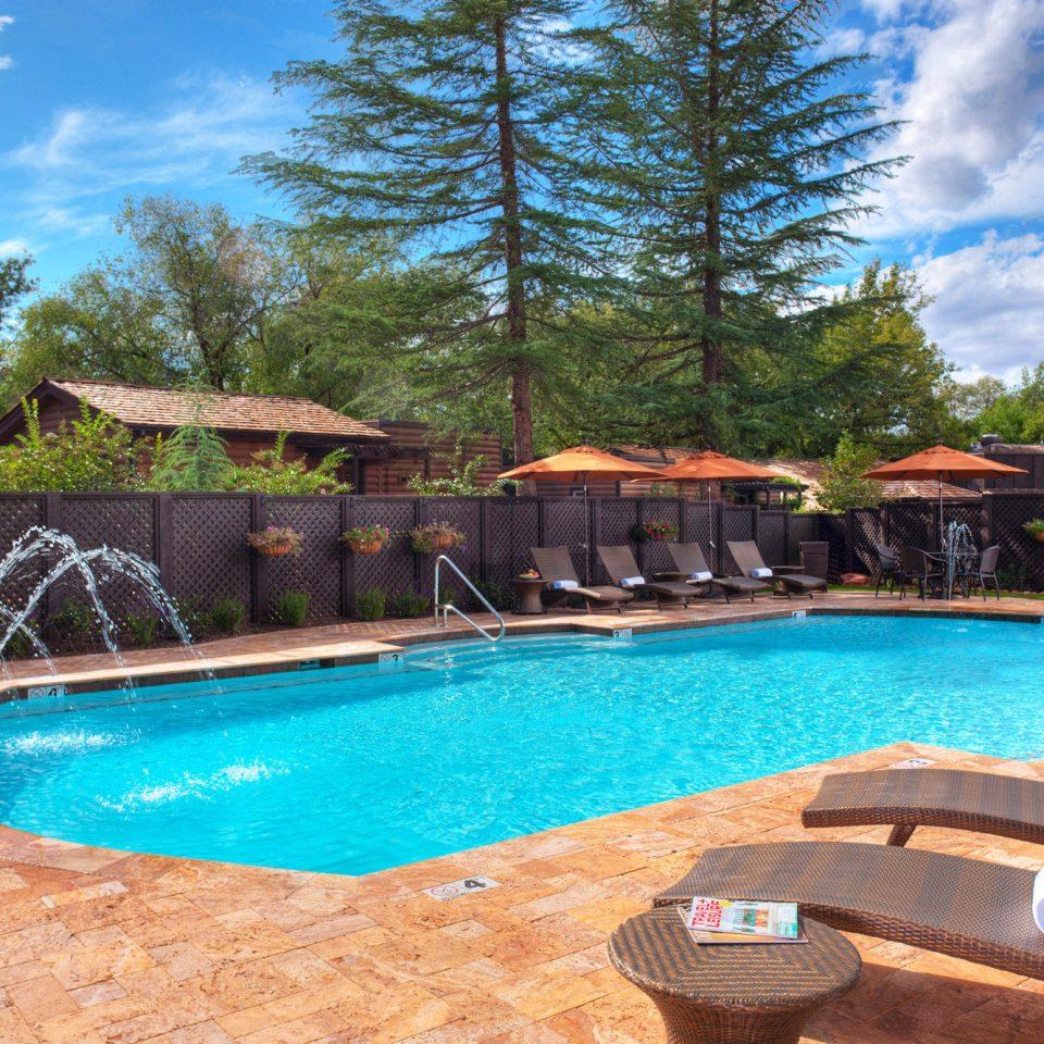 Luxury Outdoors Pool Romance Romantic tree sky swimming pool property blue backyard Resort Villa swimming